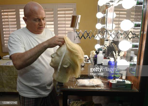 Actor comedian and writer John Di Domenico puts on a wig as he gets ready to record videos for the Cameo personalized message website as US President...