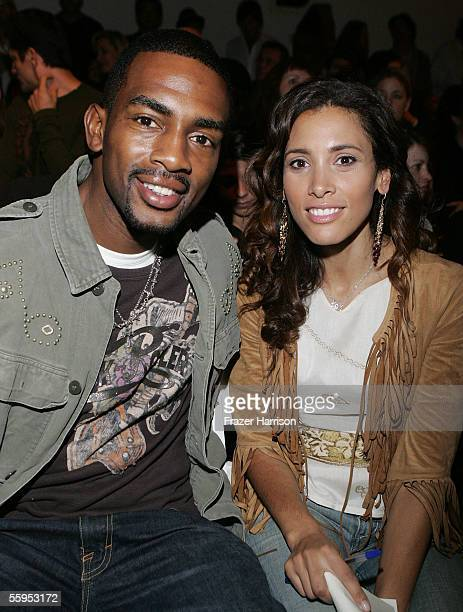 Actor comedian Bill Bellamy and wife Kristen Bellamy pose in the front row at the YaYa Spring 2006 show during MercedesBenz Fashion Week at Smashbox...
