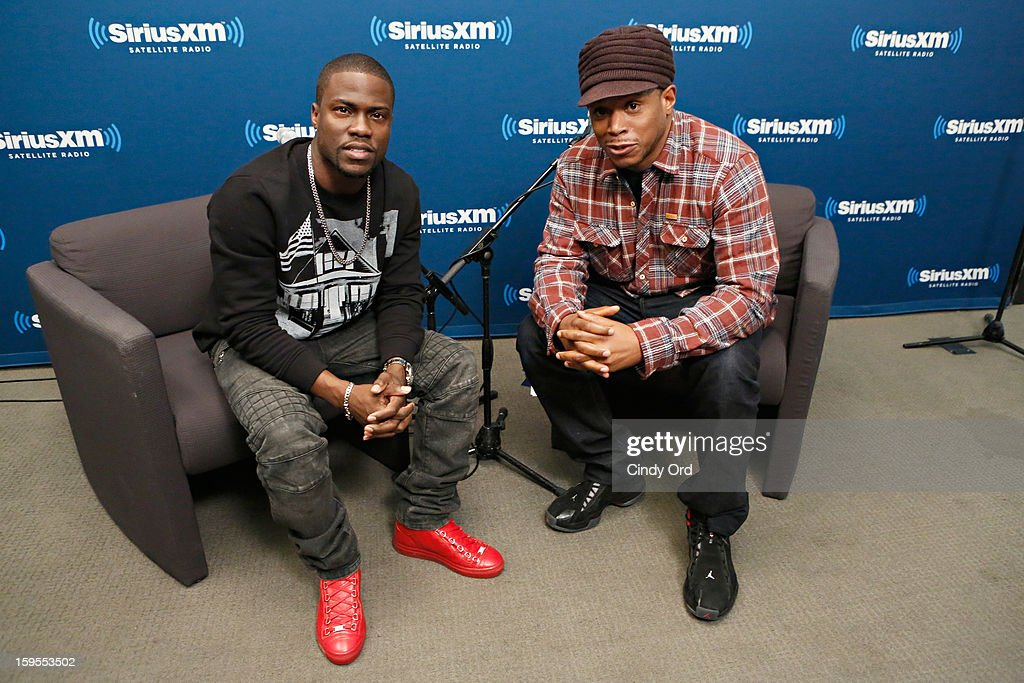 Actor/ comedian Kevin Hart poses with SiriusXM host Sway Calloway during 'SiriusXM's Town Hall with Kevin Hart' moderated by Sway Calloway on Raw Dog Comedy at the SiriusXM studios on January 15, 2013 in New York City.
