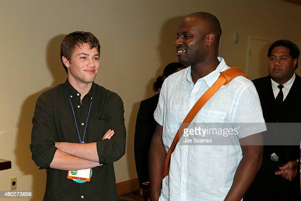 Actor Connor Jessup and writer/director Olatunde Osunsanmi attend the Falling Skies press room during TNT at ComicCon International San Diego 2015 on...