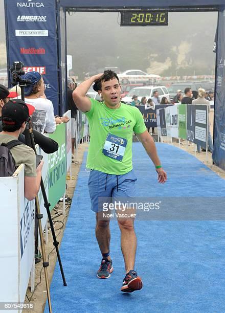Actor Conrad Ricamora participates in the Nautica Malibu Traithalon presented by Equinox at Zuma Beach on September 18 2016 in Malibu California