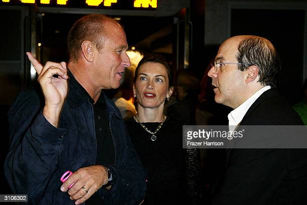 Actor Corbin Bernsen with wife Amanda talk to Jeff Wachtel Executive Vice President Original Scripted Programming USA Network at the world premiere...