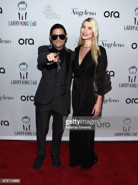 Actor Corey Feldman and Courtney Anne Mitchell arrive at Larry King's 60th Broadcasting Anniversary Event at HYDE Sunset Kitchen Cocktails on May 1...