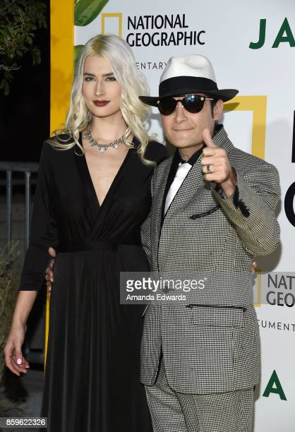 Actor Corey Feldman and model Courtney Anne Mitchell arrive at the premiere of National Geographic Documentary Films' 'Jane' at the Hollywood Bowl on...