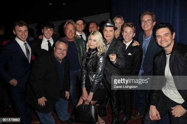 Actor Corey Feldman and wife model Courtney Anne Mitchell pose with cast members and filmmakers at a screening of 'A Tale of Two Coreys' at ArcLight...
