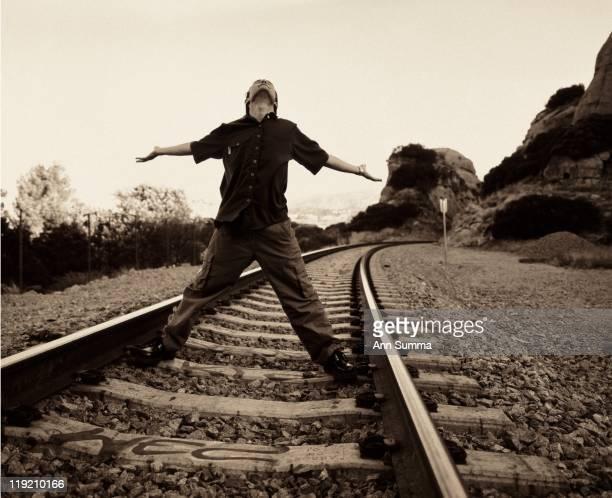 Actor Corey Feldman poses on the railroad tracks near his home in the San Fernando Valley of Los Angeles California in circa 1995
