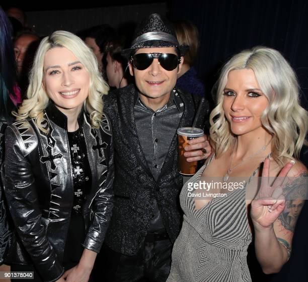 Actor Corey Feldman wife model Courtney Anne Mitchell and guest attend a screening of A Tale of Two Coreys at ArcLight Sherman Oaks on January 4 2018...