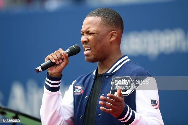 US actor Corey Hawkins sings the national anthem before the start of the 2017 US Open Men's Singles final match between Spain's Rafael Nadal and...