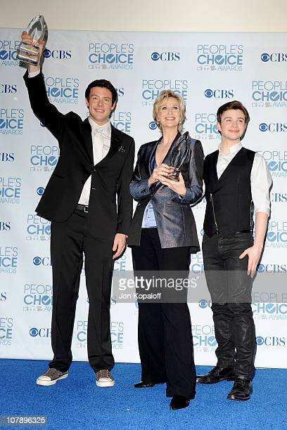 Actor Cory Monteith actress Jane Lynch and actor Chris Colfer pose with the Favorite TV Comedy Award for 'Glee' in the press room during the 2011...