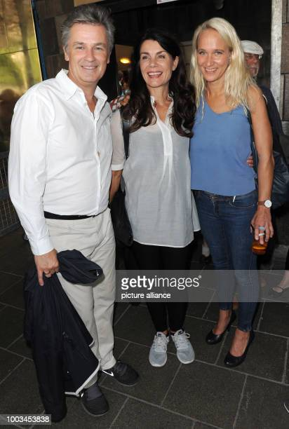 Actor couple Timothy Peach and Nicola Tiggeler and Annik Wecker wife of singersongwriter Konstantin Wecker laugh before the befinning of Konstantin...