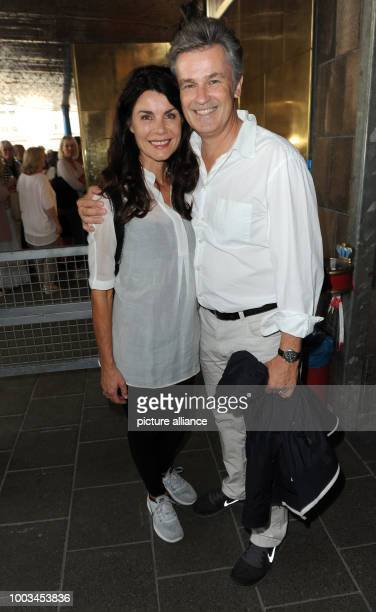 Actor couple Timothy Peach and Nicola Tiggeler smile before the befinning of singersongwriter Konstantin Wecker's birthday concert at Circus Krone in...