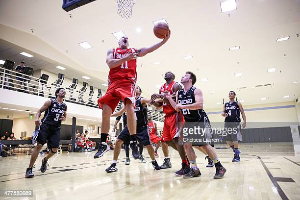Actor Craig Frank actor Greg Finley NFL player Terrell Owens actor Jimmy Tatro and actor Cory Hardrict attend the ELeague celebrity basketball league...