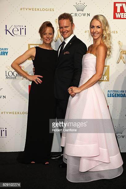 Actor Craig McLachlan poses for a photo with partner Vanessa Scammell and fellow actor Nadine Garner at the 58th Annual Logie Awards at Crown...