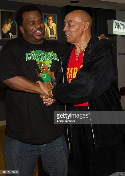 Actor Craig Robinson and Harlem Globe Trotter Curly Neal visit SiriusXM Studios on February 12 2013 in New York City