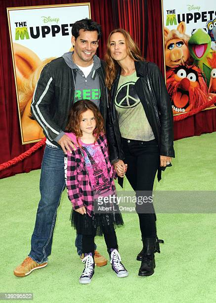Actor Cristian de la Fuente and actress Angelica Castro with daughter Laura arrive for 'The Muppets' Los Angeles Premiere held at the El Capitan...