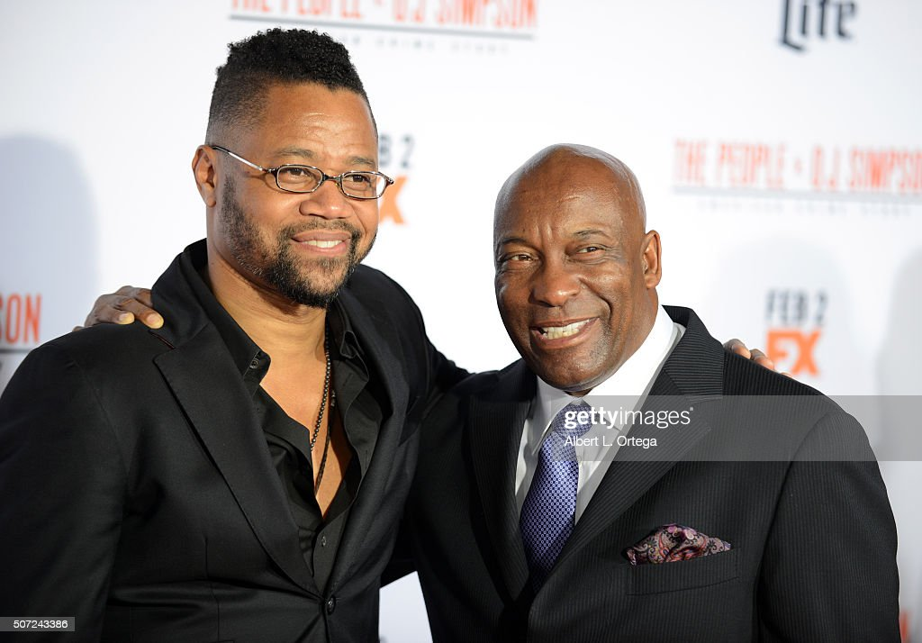 Actor Cuba Gooding Jr. and director John Singleton arrive for Premiere Of 'FX's 'American Crime Story - The People V. O.J. Simpson' held at Westwood Village Theatre on January 27, 2016 in Westwood, California.