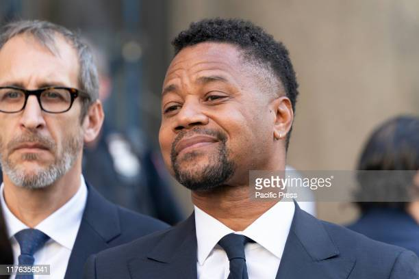 Actor Cuba Gooding Jr. Listens as his attorney Mark Heller addresses press after his arraignment in New York State Supreme Court in the Manhattan....
