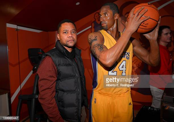 Actor Cuba Gooding Jr poses next to a wax figure of NBA player Kobe Bryant as he attends Relativity Media's Movie 43 Los Angeles Premiere After Party...