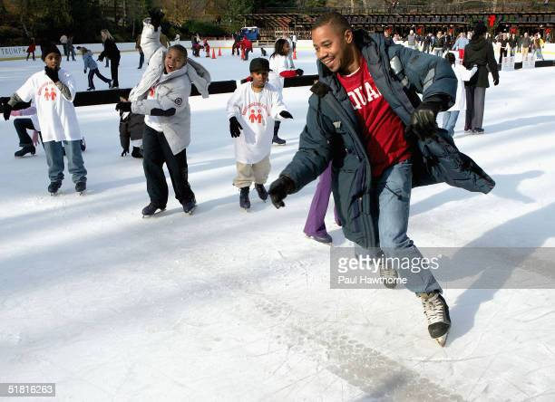 Actor Cuba Gooding Jr skates with children from the Madison Square Boys Girls Club at Wollman Skating Rink in Central Park December 2 2004 in New...