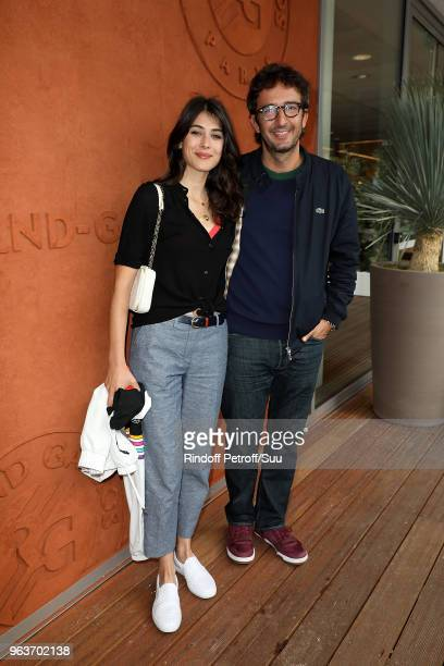 Actor Cyrille Eldin and Sandrine Calvayrac attend the 2018 French Open Day Four at Roland Garros on May 30 2018 in Paris France