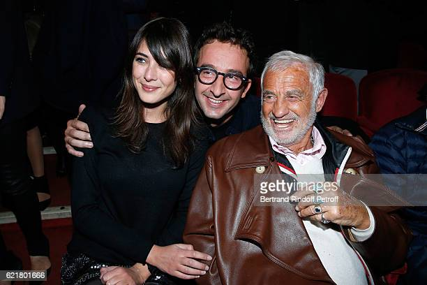 Actor Cyrille Eldin sitting between his companion journalist Sandrine Calvayrac and actor JeanPaul Belmondo attend LouisMichel Colla the Director of...
