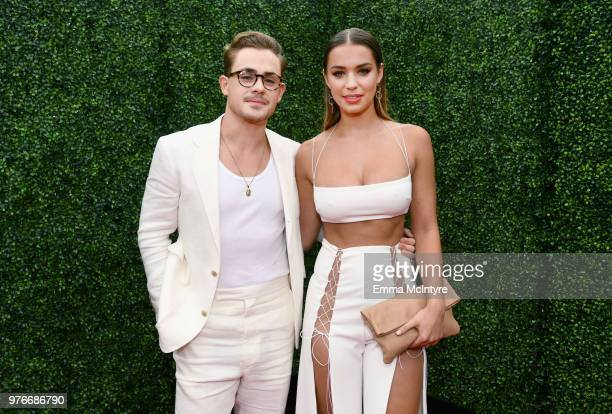 Actor Dacre Montgomery and model Liv Pollock attend the 2018 MTV Movie And TV Awards at Barker Hangar on June 16 2018 in Santa Monica California