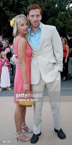 Actor Damian Lewis and his girlfriend Katie Razzall arrive at the film premiere of Band Of Brothers August 29 2001 Los Angeles CA