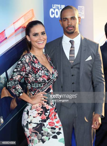 Actor Damon Wayans Jr and Samara Saraiva attend the premiere of Twentieth Century Fox's Let's Be Cops at ArcLight Hollywood on August 7 2014 in...