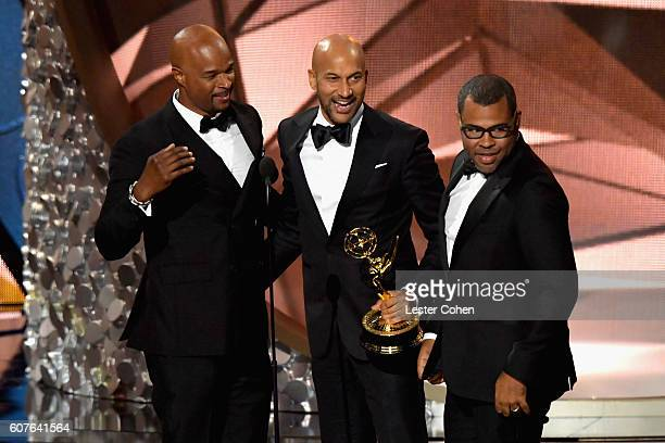 Actor Damon Wayans presents the Oustanding Variety Sketch Series award for 'Key Peele' to actor/producers KeeganMichael Key and Jordan Peele onstage...