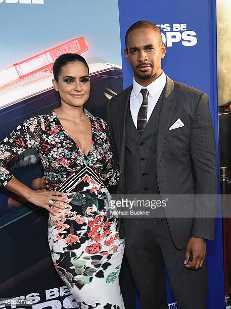 Actor Damon Wayns Jr and Samara Saraiva arrive at the premiere of Twentieth Century Fox's Let's Be Cops at ArcLight Hollywood on August 7 2014 in...