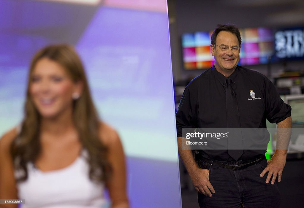 Actor Dan Ackroyd, co-founder of Crystal Head Vodka, smiles before the start of a Bloomberg Television interview in New York, U.S., on Wednesday, July 31, 2013. Founded with artist John Alexander, Crystal Head takes its name from the eerie skull-shaped bottle it comes in. Photographer: Jin Lee/Bloomberg via Getty Images