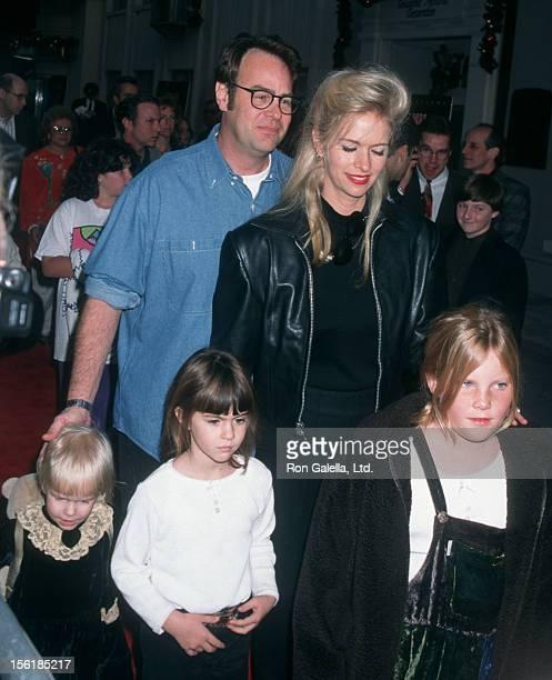 Actor Dan Aykroyd actress Donna Dixon and daughters Danielle Aykroyd and Belle Aykroyd attend the world premiere of 'Jumanji' on December 10 1995 at...