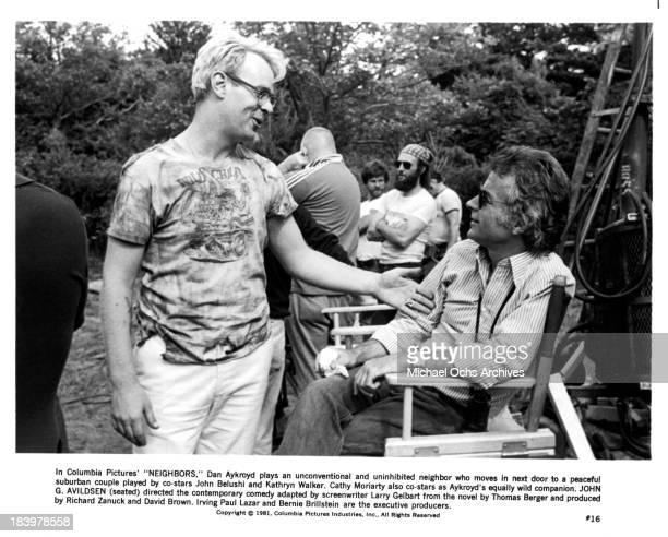 Actor Dan Aykroyd and Director John G Avildsen on set of the Columbia Pictures movie 'Neighbors' in 1981