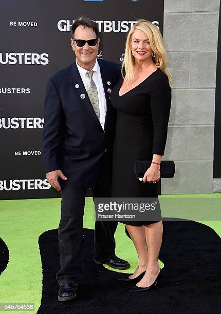 Actor Dan Aykroyd and Donna Dixon arrives at the Premiere of Sony Pictures' Ghostbusters at TCL Chinese Theatre on July 9 2016 in Hollywood California