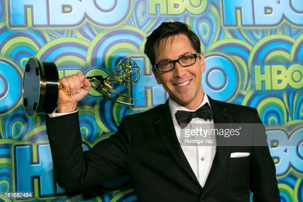 Actor Dan Bucatinsky arrives at HBO's Annual Primetime Emmy Awards Post Award Reception with his award for Outstanding Guest Actor in a Drama Series...