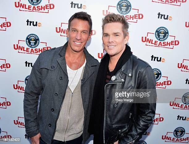 Actor Dan Cortese and TV personality Mark McGrath pose at the Guinness World Records Unleashed Arena in Times Square on November 6 2013 in New York...