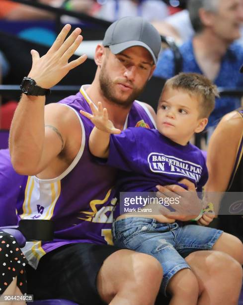 Actor Dan Ewing with son Archer during the round 14 NBL match between the Sydney Kings and the Adelaide 36ers at Qudos Bank Arena on January 13 2018...