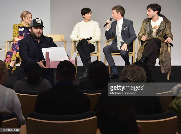 Actor Dan Fogler passes out baked goods to audience members while actors Alison Sudol Katherine Waterston Eddie Redmayne and Ezra Miller attend the...