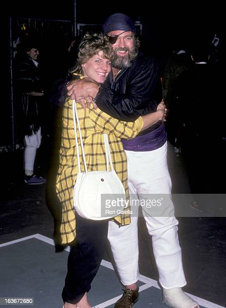 Actor Dan Haggerty and wife Samantha attend Max Baer's Halloween Party on October 31 1985 at Max Baer's home in Beverly Hills California