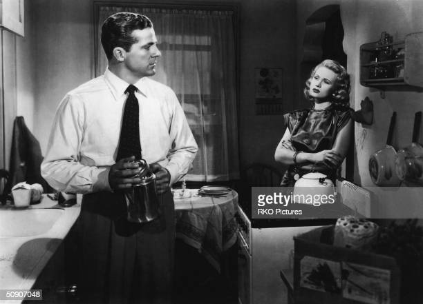 Actor Dana Andrews speaks to Virginia Mayo in a still from the film 'The Best Years of Our Lives' directed by William Wyler 1946