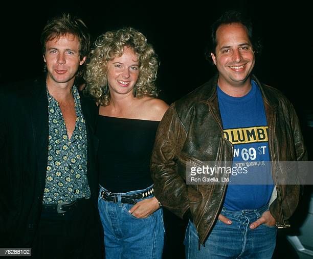 Actor Dana Carvey wife Paula Swaggerman and Jon Lovitz being photographed on August 8 1988 at Ed Debevic's Restaurant in West Hollywood California