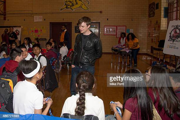 Actor Dane DeHaan attends The Amazing SpiderMan 2 Be Amazing Day Volunteer Day at IS 145 Joseph Pulitzer on April 25 2014 in the Queens borough of...