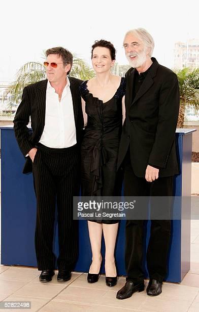 Actor Daniel Auteuil actress Juliette Binoche and director Michael Haneke attend a photocall promoting the film Cache at the Palais during the 58th...