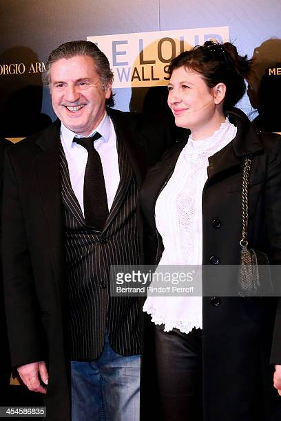 Actor Daniel Auteuil with his wife Aude attend the photocall before the 'The Wolf of Wall Street' World movie Premiere at Cinema Gaumont Opera on...