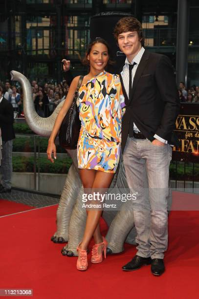 Actor Daniel Axt and partner attend the 'Wasser fuer die Elefanten' Germany premiere at CineStar on April 27 2011 in Berlin Germany