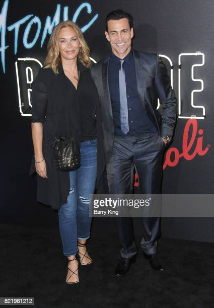 Actor Daniel Bernhardt and wife Lisa Stothard attend the premiere of Focus Features' 'Atomic Blonde' at The Theatre at Ace Hotel on July 24 2017 in...