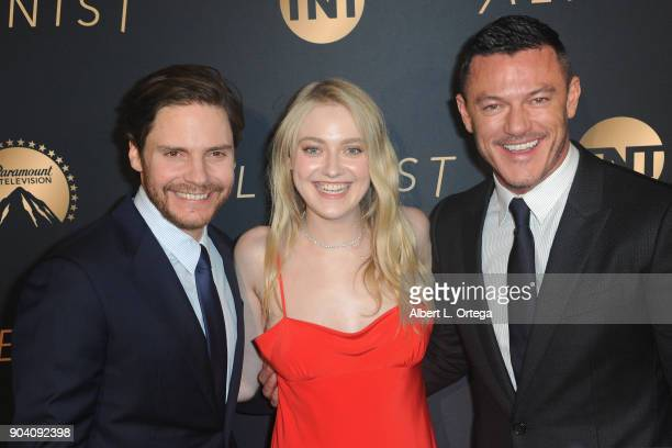 Actor Daniel Brühl actress Dakota Fanning and actor Luke Evans arrive for the Premiere Of TNT's 'The Alienist' held at Paramount Pictures on January...