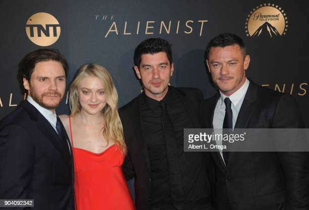 Actor Daniel Brühl actress Dakota Fanning Executive Producer/director and actor Luke Evans arrive for the Premiere Of TNT's 'The Alienist' held at...