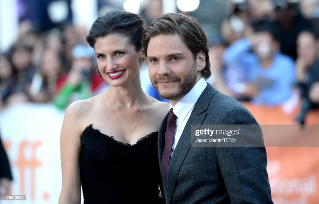 Actor Daniel Brühl (R) and Felicitas Rombold arrive at 'The Fifth Estate' premiere during the 2013 Toronto International Film Festival on September 5, 2013 in Toronto, Canada.