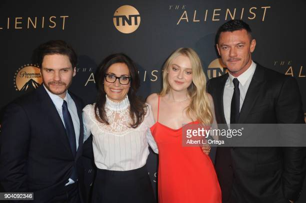 Actor Daniel Brühl Sarah Aubrey actress Dakota Fanning and actor Luke Evans arrive for the Premiere Of TNT's 'The Alienist' held at Paramount...